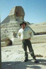 Scott Farrell on the Giza plateau standing in front of the Sphinx in Egypt